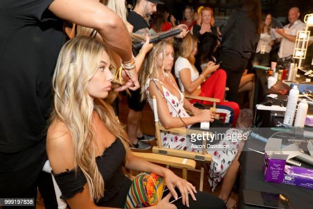 A model prepares backstage for Kaohs during the Paraiso Fashion Fair at The Setai Miami Beach on July 14 2018 in Miami Beach Florida
