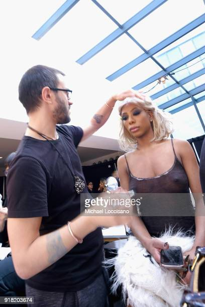A model prepares backstage for Laquan Smith during New York Fashion Week The Shows at Gallery I at Spring Studios on February 14 2018 in New York City