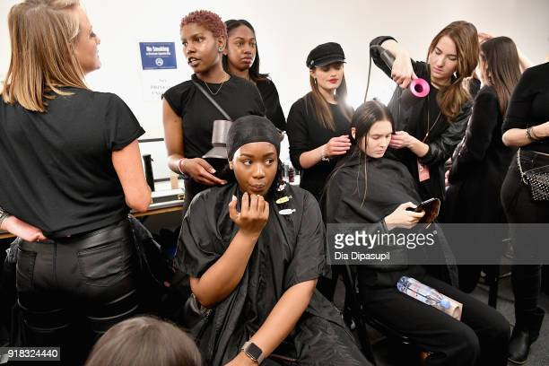 A model prepares backstage for Leanne Marshall during New York Fashion Week The Shows at Gallery II at Spring Studios on February 14 2018 in New York...
