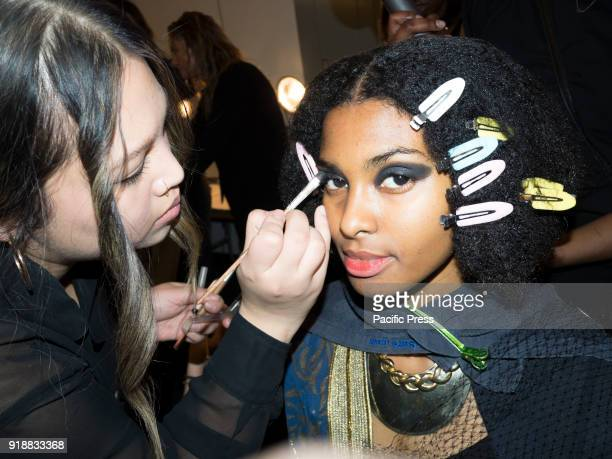 A model prepares backstage for Leanne Marshall Fall/Winter 2018 runway show during New York Fashion Week at Spring Studios Manhattan