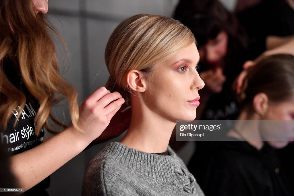 A model prepares backstage for Marcel Ostertag during New York Fashion Week: The Shows at Gallery II at Spring Studios on February 14, 2018 in New York City.