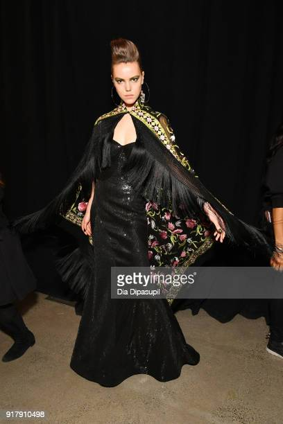 A model prepares backstage for Naeem Khan during New York Fashion Week The Shows at Gallery I at Spring Studios on February 13 2018 in New York City