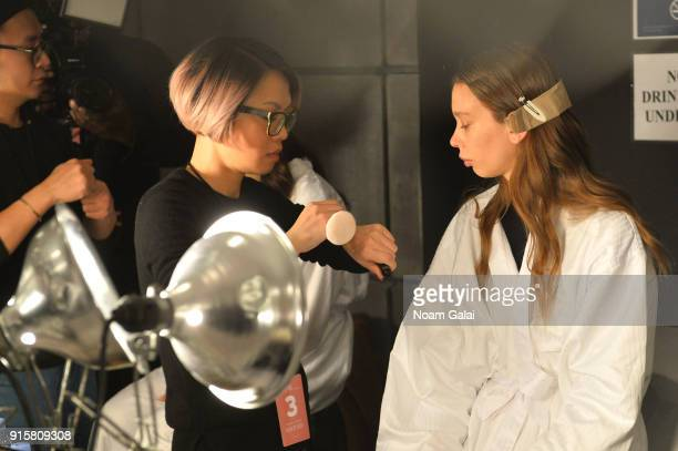 A model prepares backstage for Noon By Noor during New York Fashion Week The Shows at Gallery II at Spring Studios on February 8 2018 in New York City