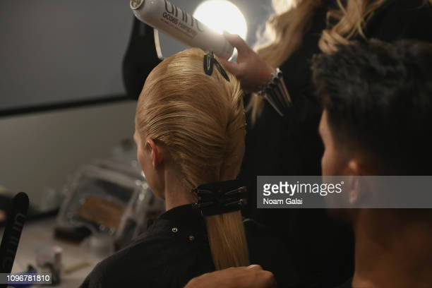 A model prepares backstage for Pony x Harbin fashion show during New York Fashion Week The Shows at Gallery I at Spring Studios on February 9 2019 in...
