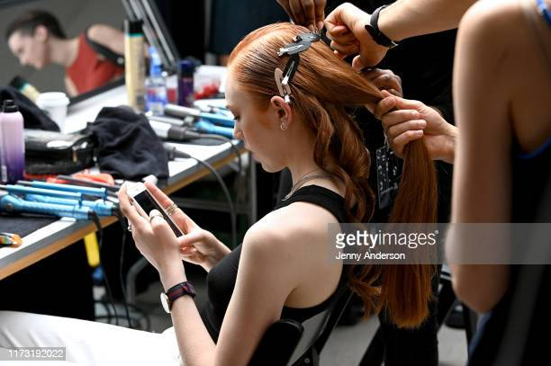 A model prepares backstage for Raisavanessa during New York Fashion Week The Shows at Gallery I at Spring Studios on September 08 2019 in New York...