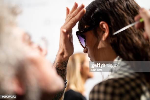 A model prepares backstage for 'Roberto Torreta' fashion show during MercedesBenz Madrid Fashion Week in Madrid Spain July 09 2018