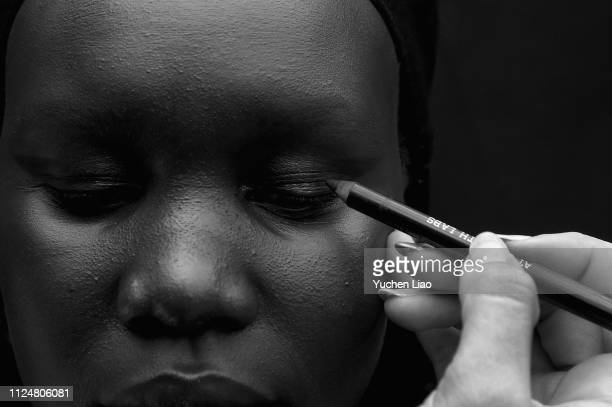 A model prepares backstage for Rosa Cha fashion show during New York Fashion Week The Shows at Gallery I at Spring Studios on February 13 2019 in New...