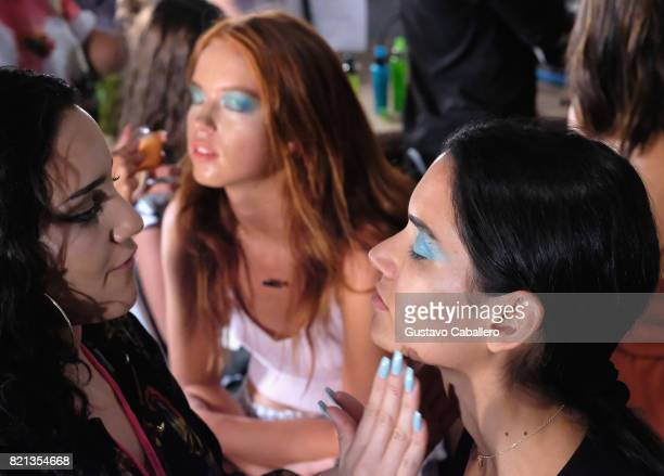 A model prepares backstage for SWIMMIAMI INDAH 2018 Collection at SWIMMIAMI tent on July 23 2017 in Miami Beach Florida