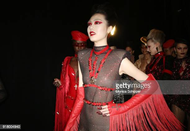A model prepares backstage for The Blonds during New York Fashion Week The Shows at Gallery I at Spring Studios on February 13 2018 in New York City