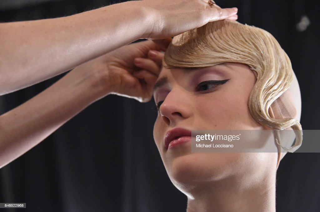 A model prepares backstage for the Chocheng fashion show during New York Fashion Week: The Shows at Gallery 3, Skylight Clarkson Sq on September 13, 2017 in New York City.