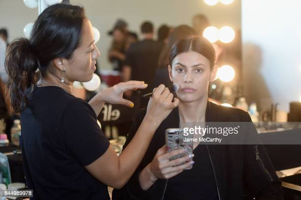A model prepares backstage for the Christian Siriano fashion show during New York Fashion Week The Shows at Pier 59 on September 9 2017 in New York...
