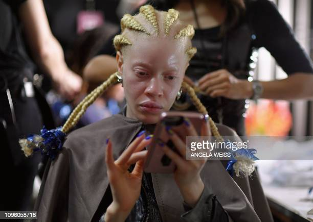 A model prepares backstage for the Chromat fashion show during New York Fashion Week The Shows at Industria Studios on February 8 2019 in New York...