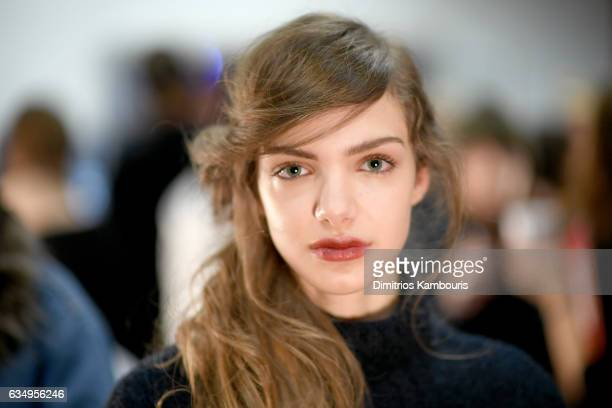 A model prepares backstage for the Jenny Packham collection during New York Fashion Week The Shows at Gallery 3 Skylight Clarkson Sq on February 12...