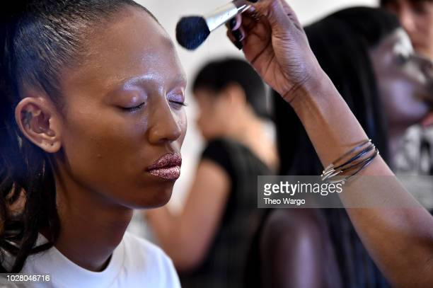 A model prepares backstage for the Jeremy Scott show during New York Fashion Week The Shows at Gallery I at Spring Studios on September 6 2018 in New...