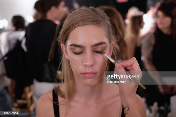 A model prepares backstage for the Leanne Marshall fashion show during New York Fashion Week September 2016 at The Gallery Skylight at Clarkson Sq on...