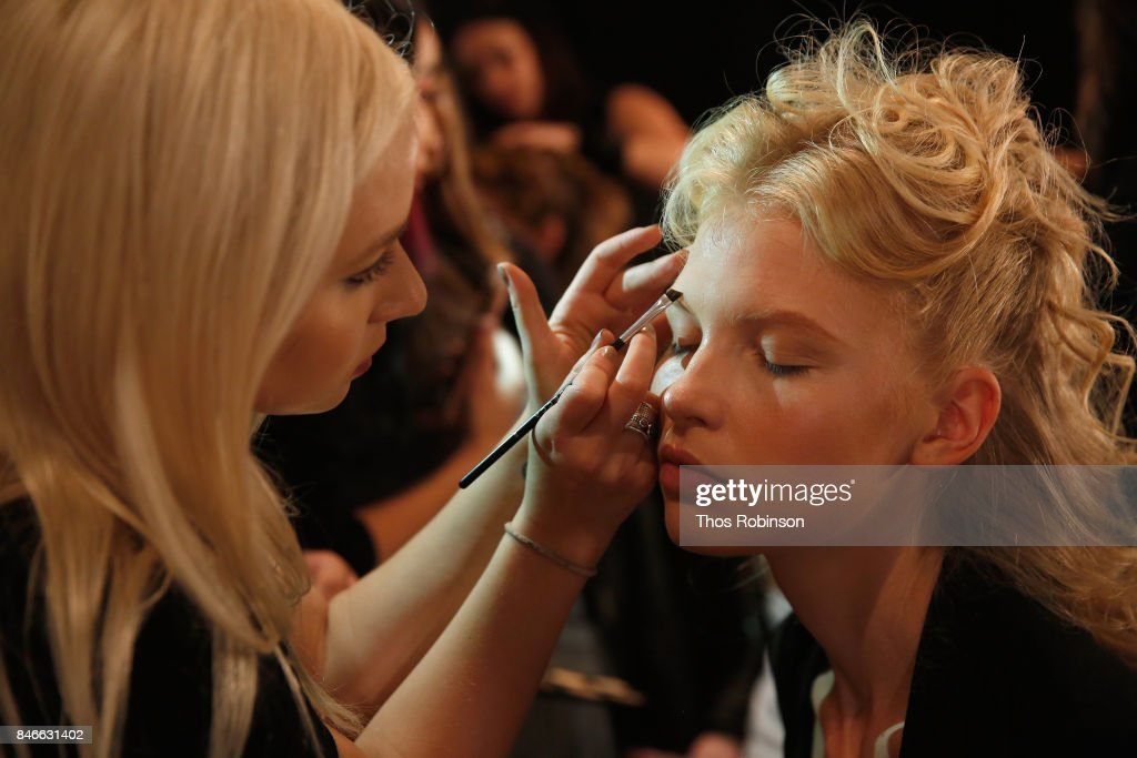 A model prepares backstage for the Marcel Ostertag fashion show during New York Fashion Week: The Shows at Gallery 3, Skylight Clarkson Sq on September 13, 2017 in New York City.