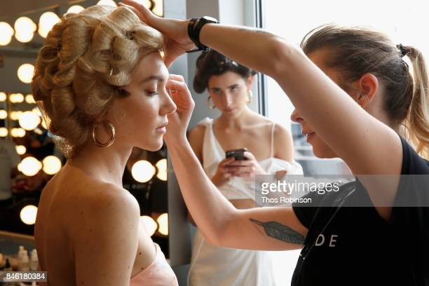 A model prepares backstage for the Palette New York Fashion Week Spring/Summer 2018 at Pier 59 on September 12 2017 in New York City