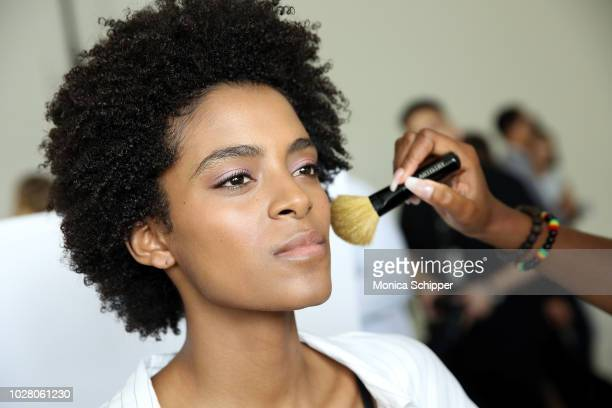 A model prepares backstage for the Pamella Roland fashion show during New York Fashion Week at Pier 59 on September 6 2018 in New York City