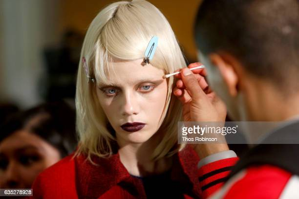 A model prepares backstage for the Philipp Plein Fall/Winter 2017/2018 Women's And Men's Fashion Show at The New York Public Library on February 13...