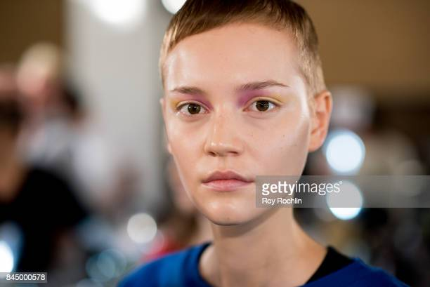 A model prepares backstage for the SelfPortrait fasion show during New York Fashion Week at SIR Stage 37 on September 9 2017 in New York City