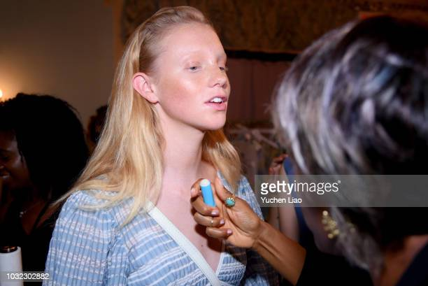 A model prepares backstage for the Staud Presentation during New York Fashion Week The Shows at Laudree on September 12 2018 in New York City