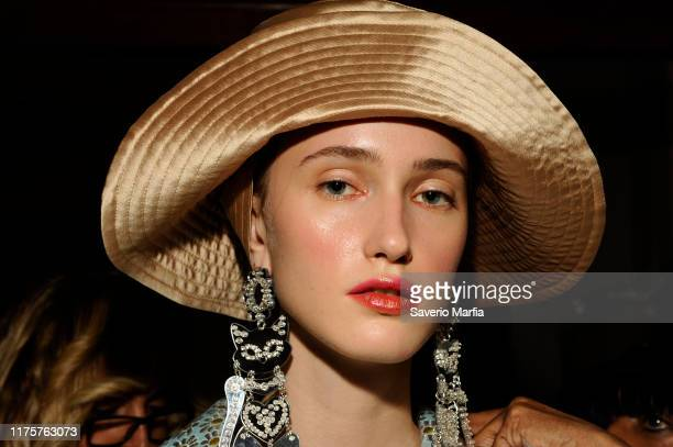 Model prepares backstage for the Vivetta fashion show during Milan Fashion Week Spring/Summer 2020 on September 19, 2019 in Milan, Italy.