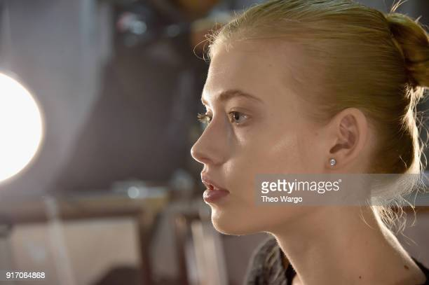 A model prepares backstage for Vivi Zubedi during New York Fashion Week The Shows at Industria Studios on February 11 2018 in New York City