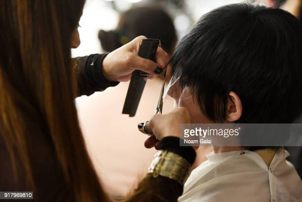 A model prepares backstage for Zang Toi during New York Fashion Week The Shows at Pier 59 on February 13 2018 in New York City