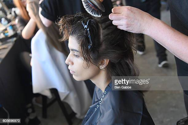A model prepares backstage hair detail for Boss Womenswear fashion show during New York Fashion Week September 2016 at The Gallery Skylight at...