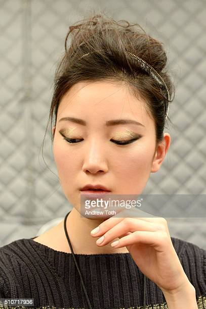 A model prepares backstage hair detail with L'Oreal Professionnel at Carmen Marc Valvo Fall 2016 at Moynihan Station on February 16 2016 in New York...