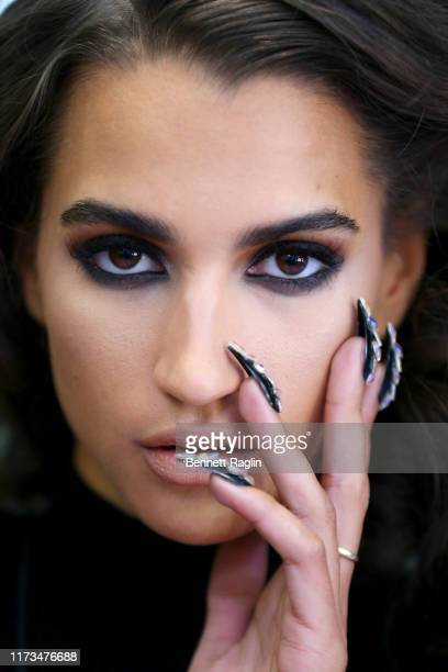 Model prepares backstage, makeup detail, for The Blonds x Moulin Rouge! The Musical during New York Fashion Week: The Shows on September 09, 2019 in...
