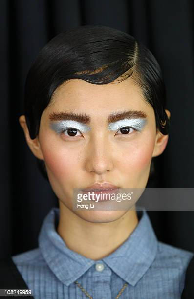 Model prepares backstage prior the Prada Spring/Summer 2011 Fashion Show on January 22, 2011 in Beijing, China.