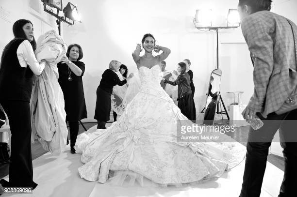 A model prepares Backstage prior the Ralph Russo Spring Summer 2018 show as part of Paris Fashion Week on January 22 2018 in Paris France