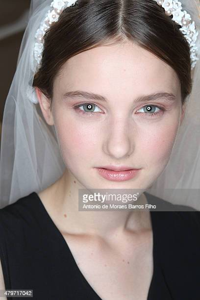 Model prepares backstage prior to Georges Hobeika show as part of Paris Fashion Week Haute-Couture Fall/Winter 2015/2016 on July 6, 2015 in Paris,...
