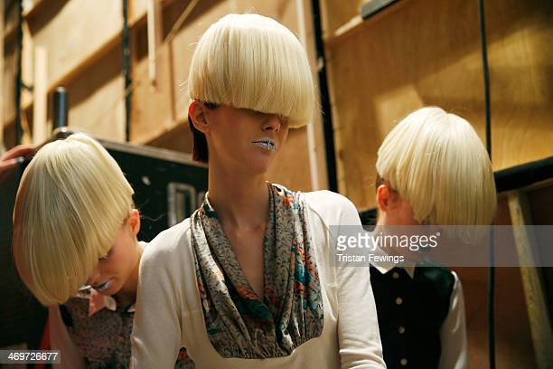 A model prepares backstage prior to the Basharatyan V show at the Fashion Scout venue during London Fashion Week AW14 at Freemasons Hall on February...