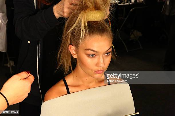 A model prepares backstage with Kagome Greens at Jeremy Scott at Skylight at Moynihan Station on September 14 2015 in New York City