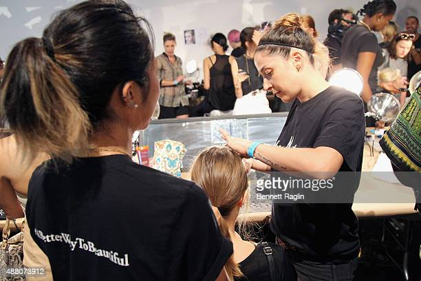 A model prepares backstage with SheaMoisture at Tracy Reese S/S 2016 during New York Fashion Week at Art Beam on September 13 2015 in New York City