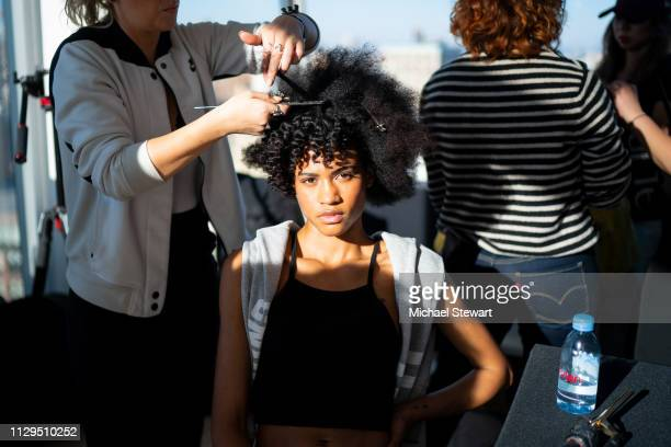 A model prepares before the Aliette Presentation during New York Fashion Week The Shows at The Standard East Village on February 13 2019 in New York...