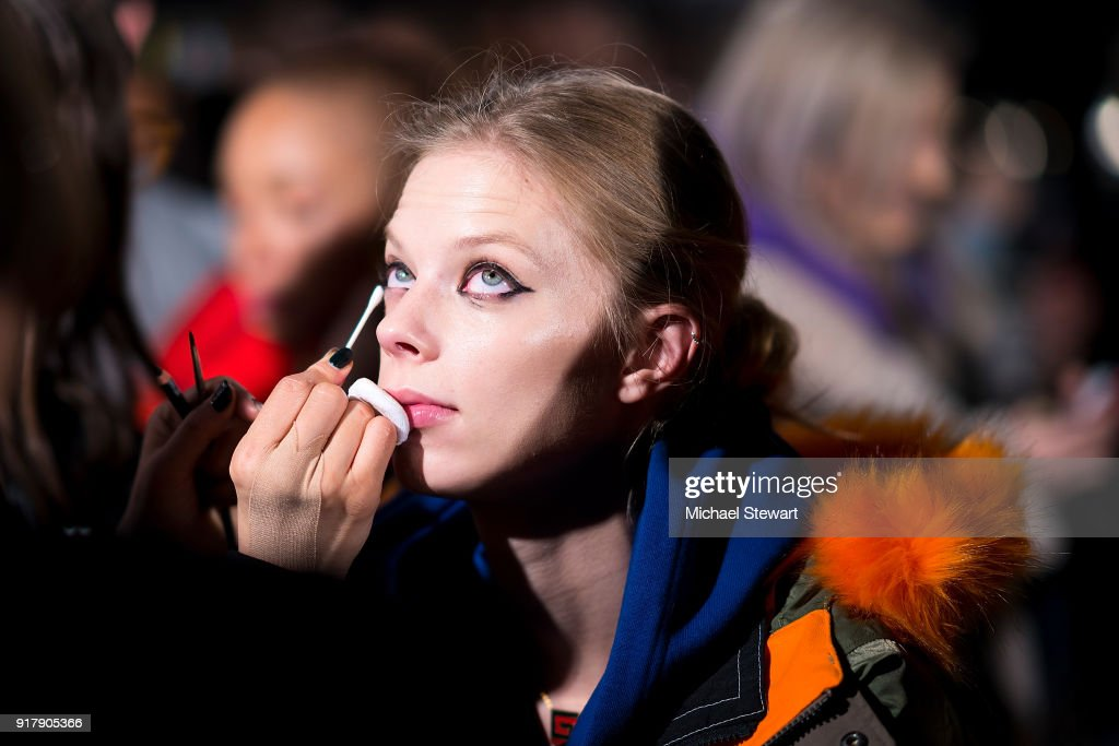 A model prepares before the Coach 1941 fashion show during New York Fashion Week on February 13, 2018 in New York City.