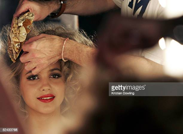 A model prepares before walking down the catwalk during the L'Oreal Paris Runway 4 of the L'Oreal Fashion Festival at Federation Square March 16 2005...