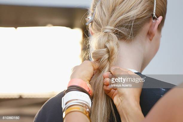 A model prepares hair detail backstage at the Jonathan Simkhai fashion show during Fall 2016 MADE Fashion Week at Milk Studios on February 14 2016 in...