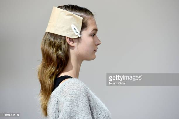 A model prepares hair detail backstage for Noon By Noor during New York Fashion Week The Shows at Gallery II at Spring Studios on February 8 2018 in...