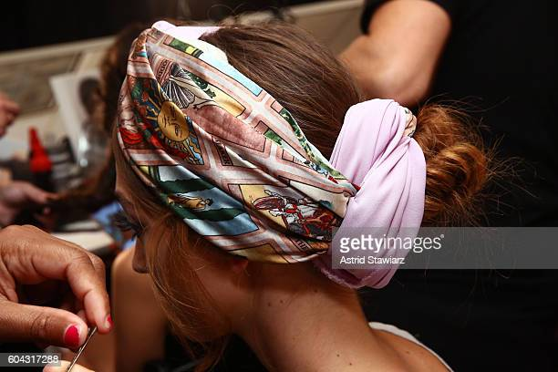 A model prepares hair detail for the Alice Olivia by Stacey Bendet Spring/Summer 2017 Presentation during New York Fashion Week September 2016 at The...