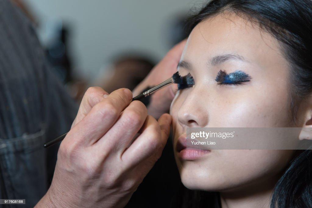 A model prepares in backstage at Zero + Maria Cornejo - Presentation - February 2018 - New York Fashion Week on February 12, 2018 in New York City.