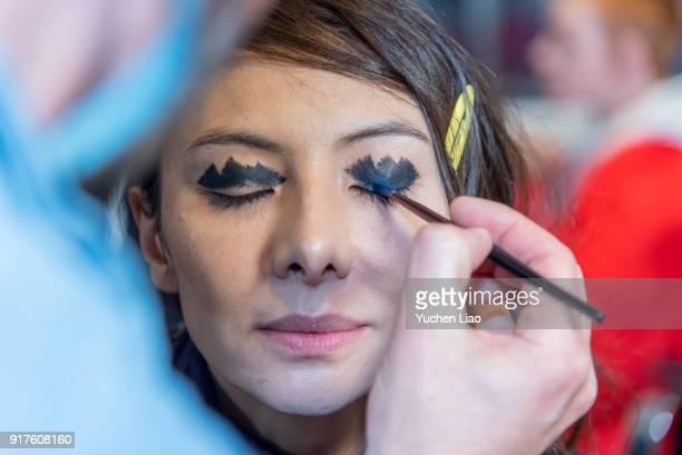 A model prepares in backstage for Zero Maria Cornejo Presentation February 2018 New York Fashion Week on February 12 2018 in New York City