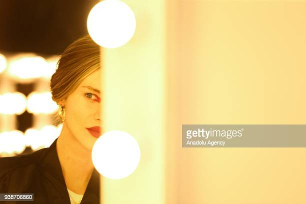 A model prepares in backstage to present a collection by Ece Kavran to advertise her new brand 'URUN' within Mercedes Benz Fashion Week 2018 in...