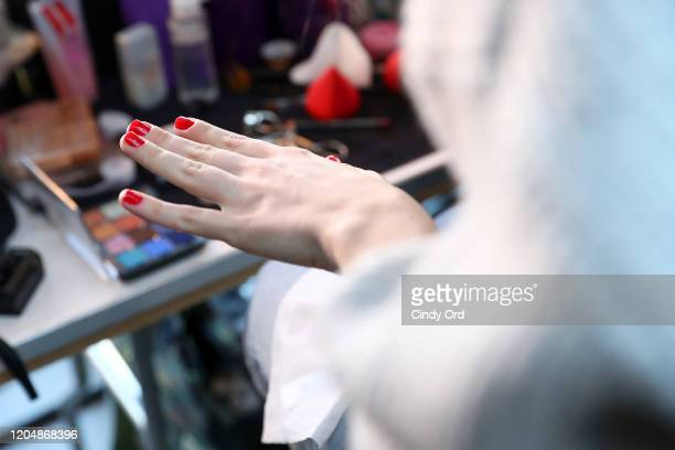 A model prepares nail detail backstage for Badgley Mischka during New York Fashion Week The Shows at Gallery I at Spring Studios on February 08 2020...