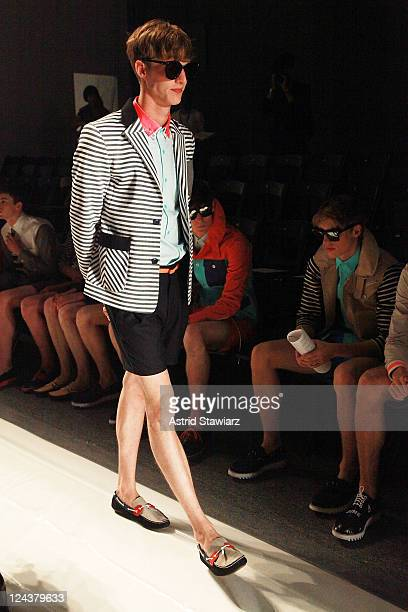 A model prepares prior to the General Idea Spring 2012 fashion show during MercedesBenz Fashion Week at The Studio at Lincoln Center on September 9...