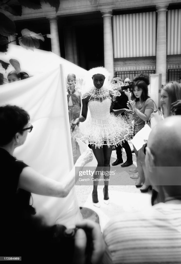 A model prepares to walk the runway for the On Aura Tout Vu show as part of Paris Fashion Week Haute-Couture Fall/Winter 2013-2014 on July 1, 2013 at the Jardins du Palais Royal in Paris, France.