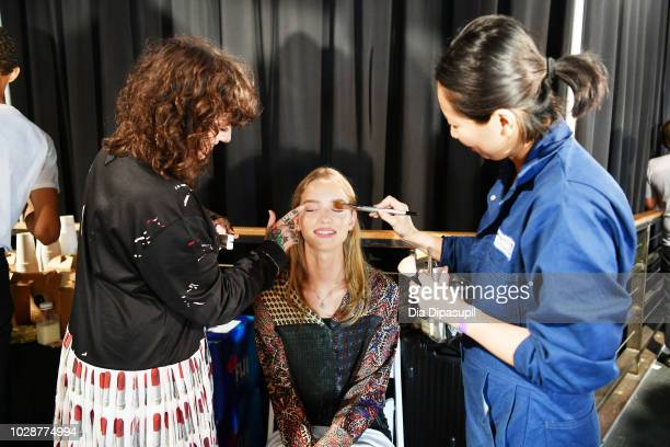 A model prepares with Maybelline backstage for the Monse show during New York Fashion Week The Shows at SIR Stage 37 on September 7 2018 in New York...